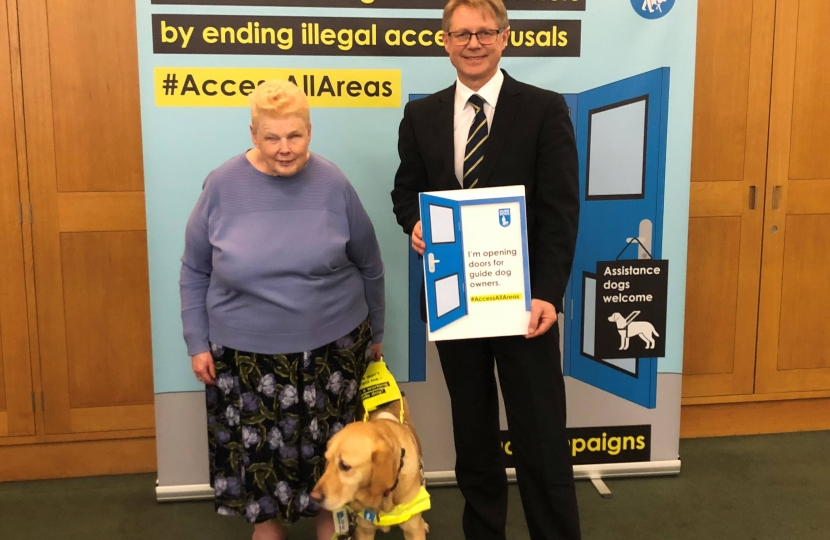 guide dog with David Morris MP